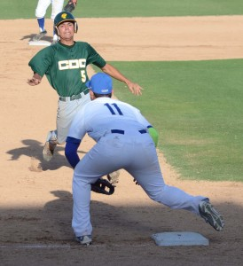 Adam Hoyos prepares to slide as Gilbert Aguilar awaits the throw