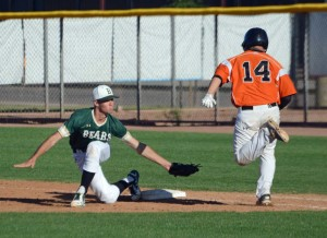 Tyler Riddle stretches to take the throw on Gehrig Sanchez's sac bunt